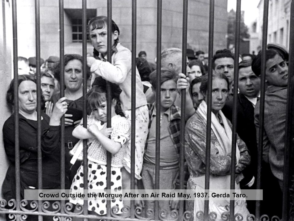 Crowd Outside the Morgue After an Air Raid May, 1937. Gerda Taro.