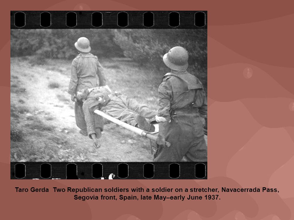 Taro Gerda Two Republican soldiers with a soldier on a stretcher, Navacerrada Pass, Segovia front, Spain, late May–early June 1937.