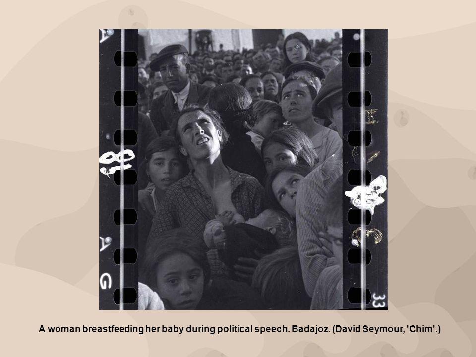 A woman breastfeeding her baby during political speech. Badajoz