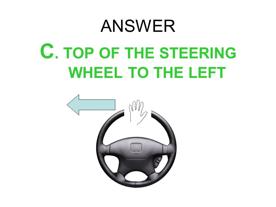 C. TOP OF THE STEERING WHEEL TO THE LEFT