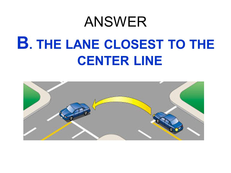 B. THE LANE CLOSEST TO THE CENTER LINE
