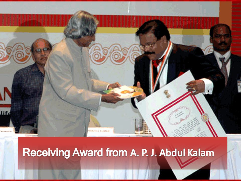 Receiving Award from A. P. J. Abdul Kalam