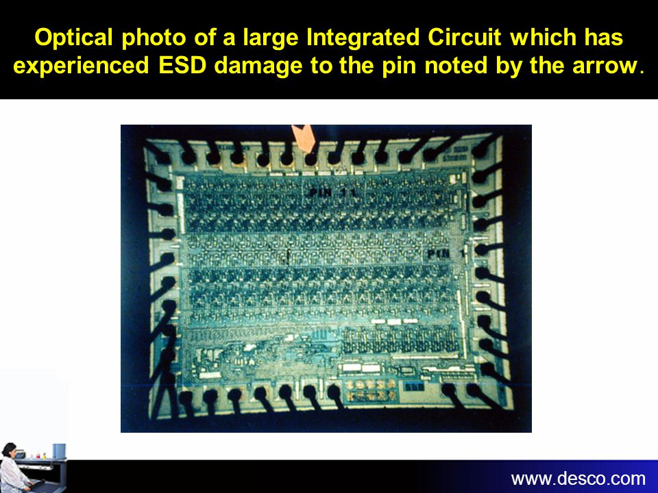 Optical photo of a large Integrated Circuit which has experienced ESD damage to the pin noted by the arrow.