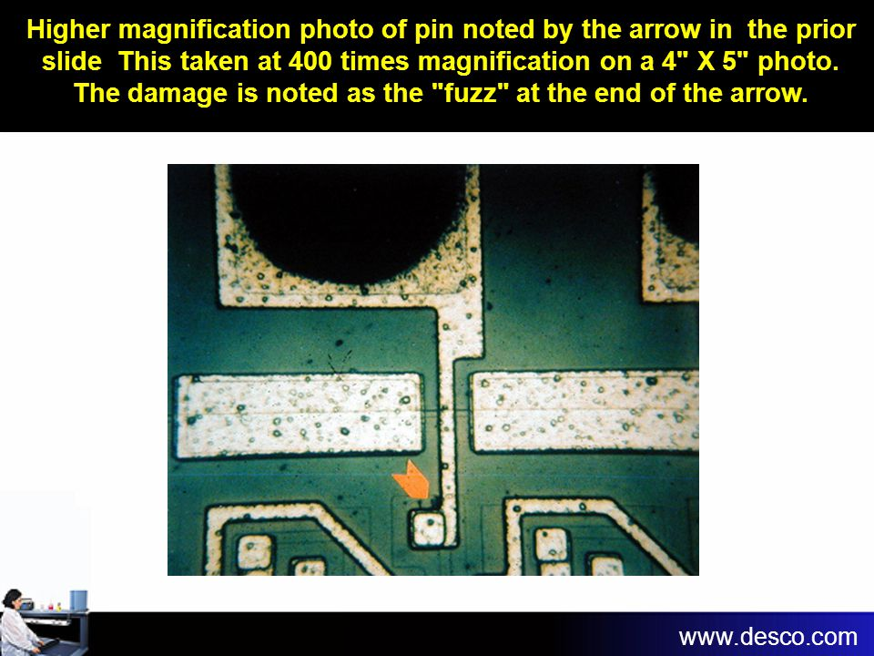 Higher magnification photo of pin noted by the arrow in the prior slide This taken at 400 times magnification on a 4 X 5 photo. The damage is noted as the fuzz at the end of the arrow.