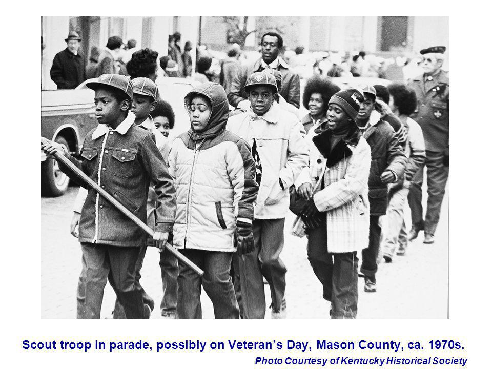 Scout troop in parade, possibly on Veteran's Day, Mason County, ca