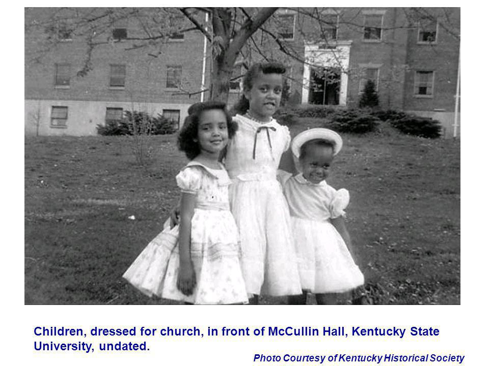 Children, dressed for church, in front of McCullin Hall, Kentucky State University, undated.