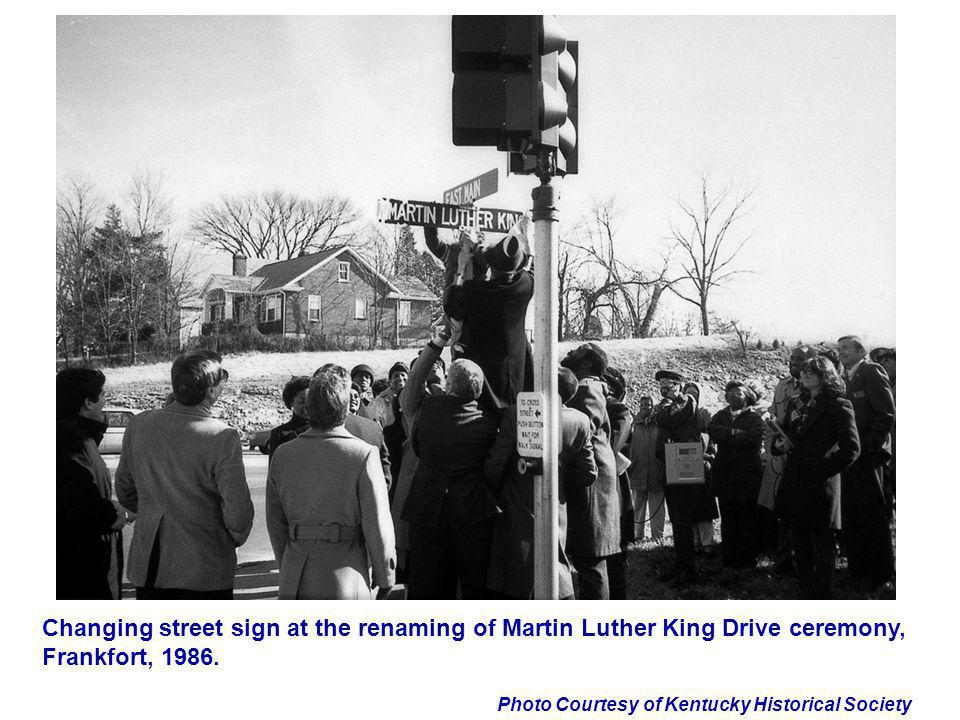 Changing street sign at the renaming of Martin Luther King Drive ceremony, Frankfort, 1986.