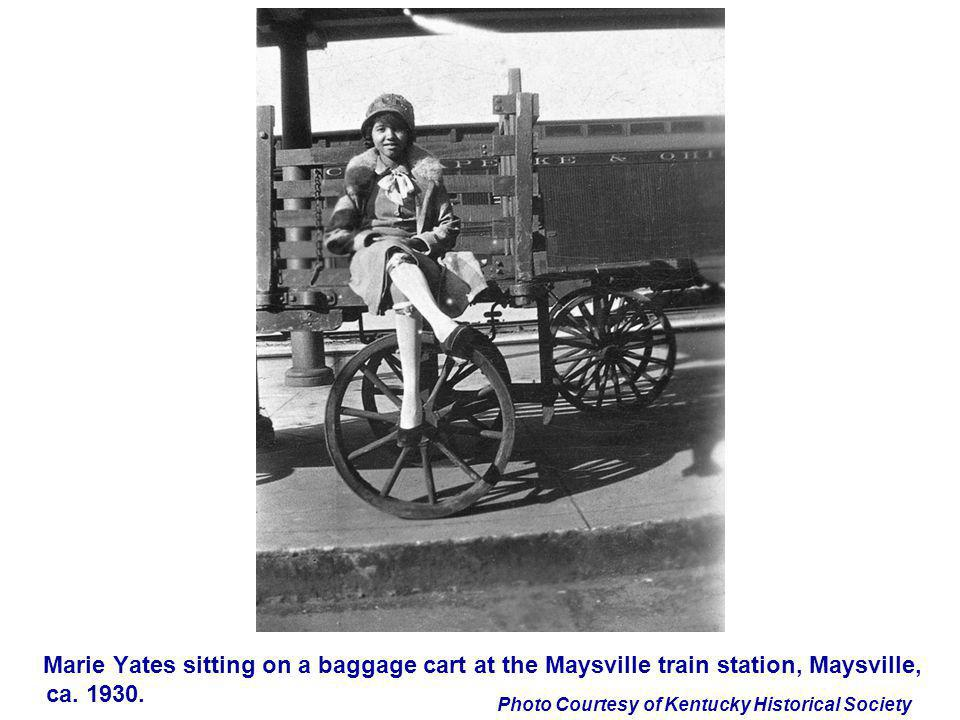 Marie Yates sitting on a baggage cart at the Maysville train station, Maysville, ca. 1930.
