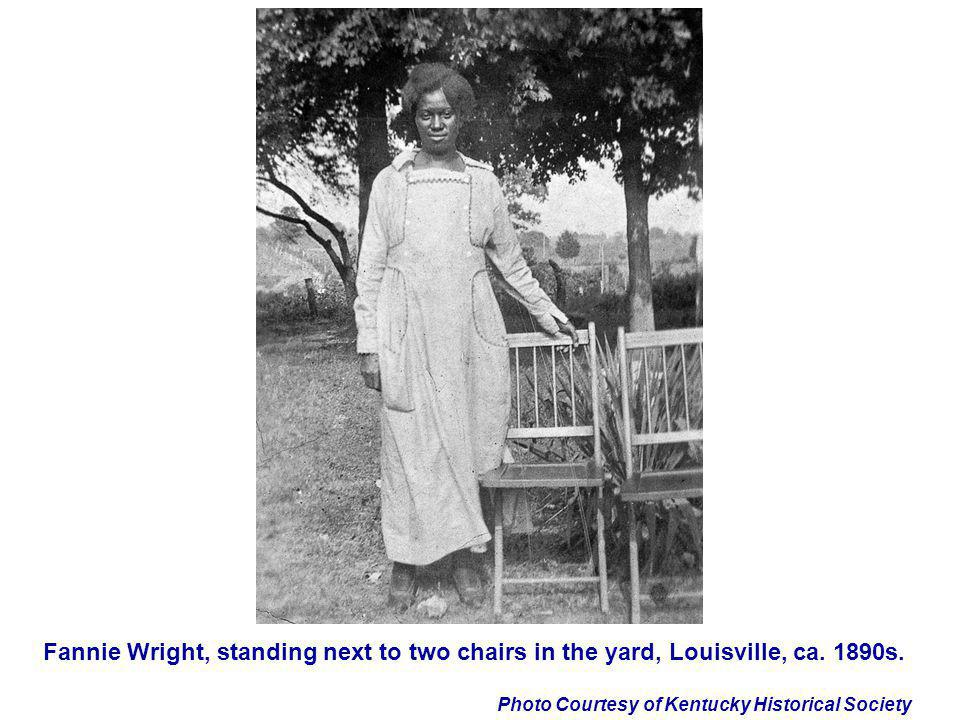 Fannie Wright, standing next to two chairs in the yard, Louisville, ca