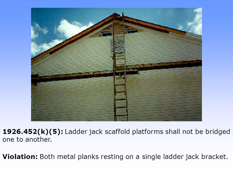Violation: Both metal planks resting on a single ladder jack bracket.