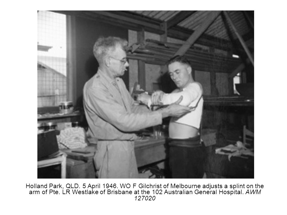 Holland Park, QLD. 5 April 1946. WO F Gilchrist of Melbourne adjusts a splint on the arm of Pte.