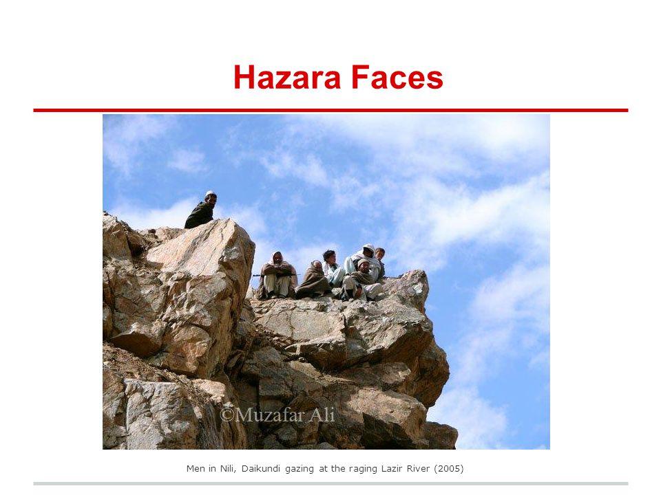 Men in Nili, Daikundi gazing at the raging Lazir River (2005)