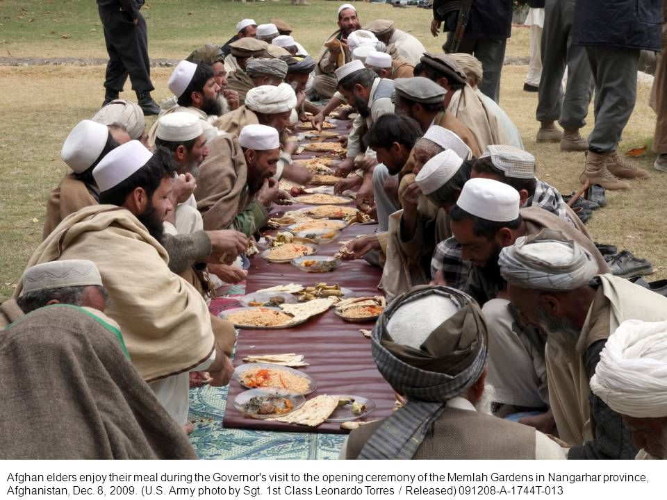 Afghan elders enjoy their meal during the Governor s visit to the opening ceremony of the Memlah Gardens in Nangarhar province, Afghanistan, Dec.
