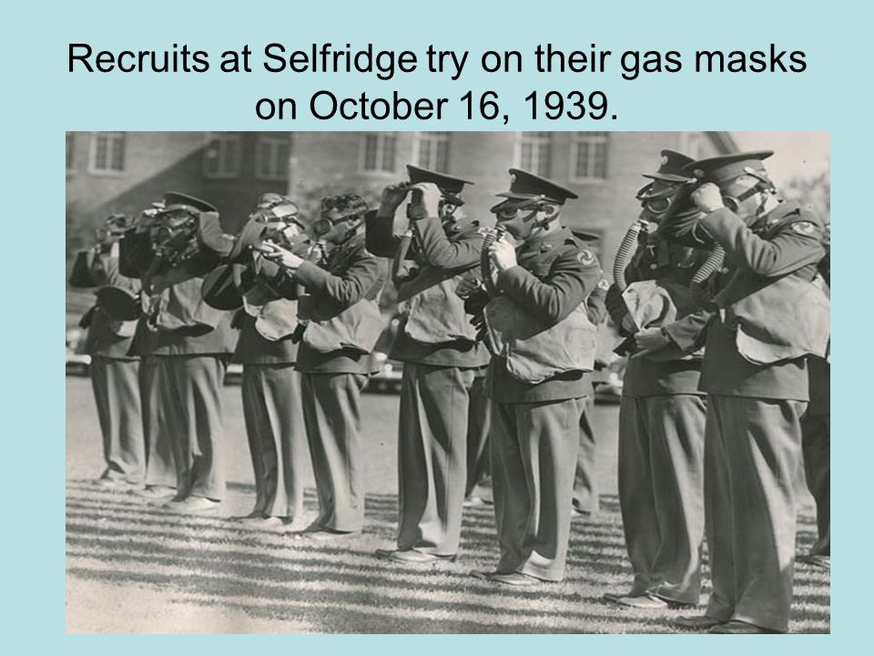 Recruits at Selfridge try on their gas masks on October 16, 1939.