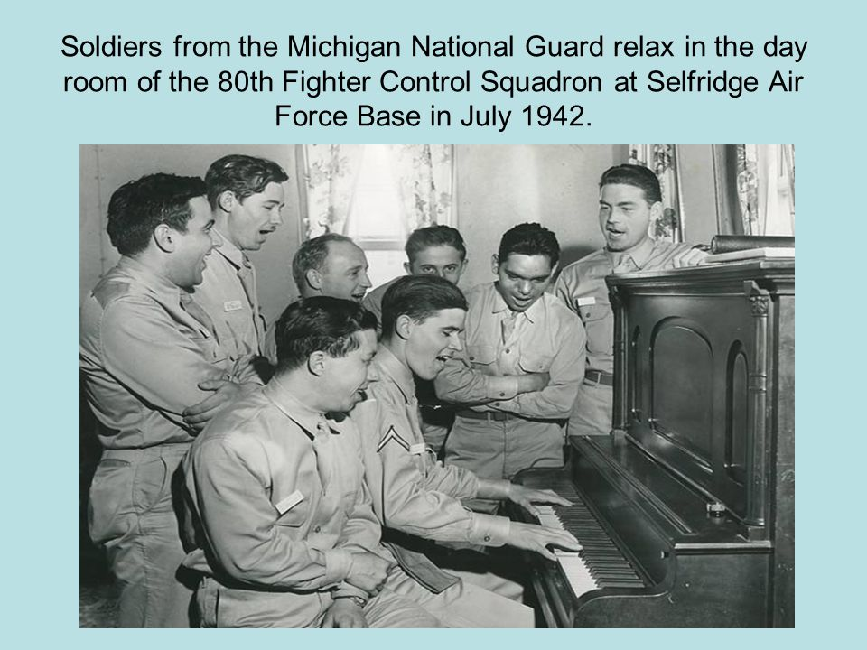 Soldiers from the Michigan National Guard relax in the day room of the 80th Fighter Control Squadron at Selfridge Air Force Base in July 1942.