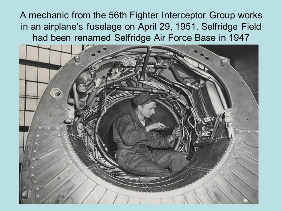 A mechanic from the 56th Fighter Interceptor Group works in an airplane's fuselage on April 29, 1951.