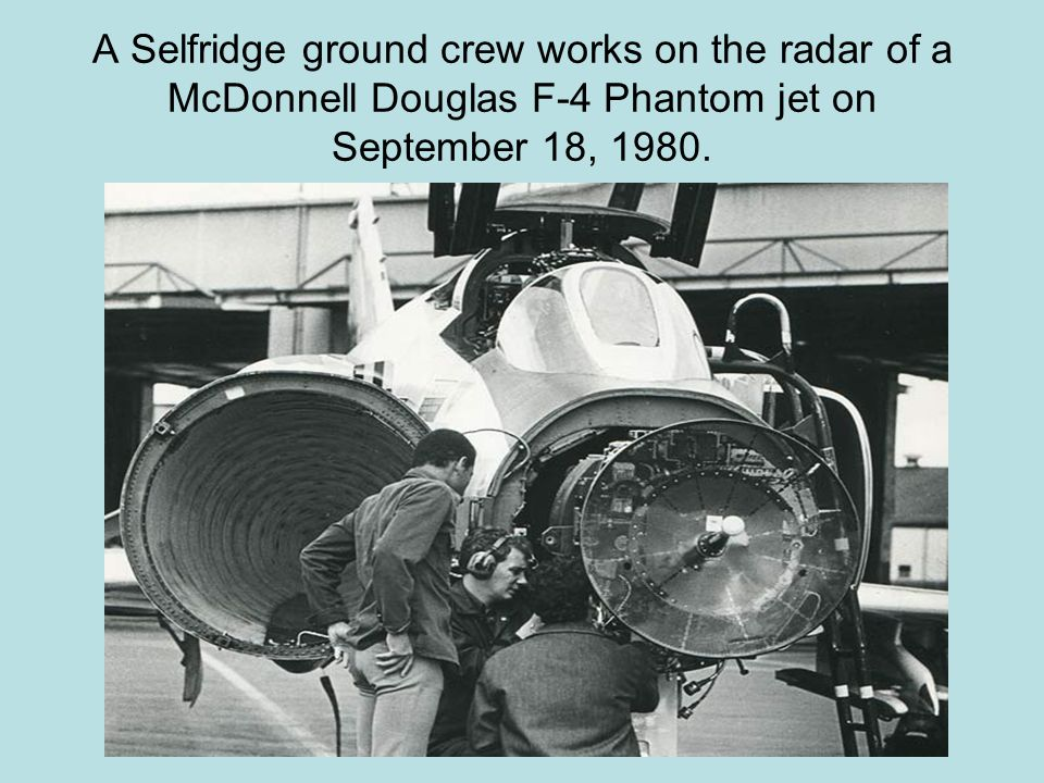 A Selfridge ground crew works on the radar of a McDonnell Douglas F-4 Phantom jet on September 18, 1980.