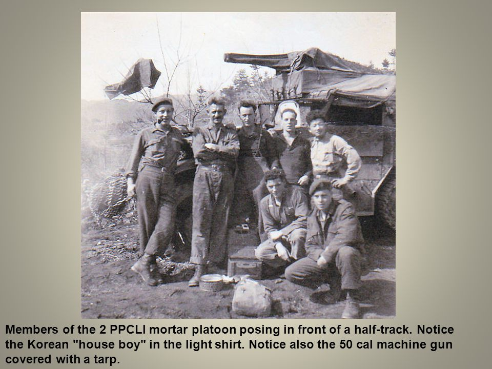 Members of the 2 PPCLI mortar platoon posing in front of a half-track