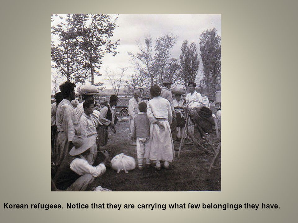 Korean refugees. Notice that they are carrying what few belongings they have.