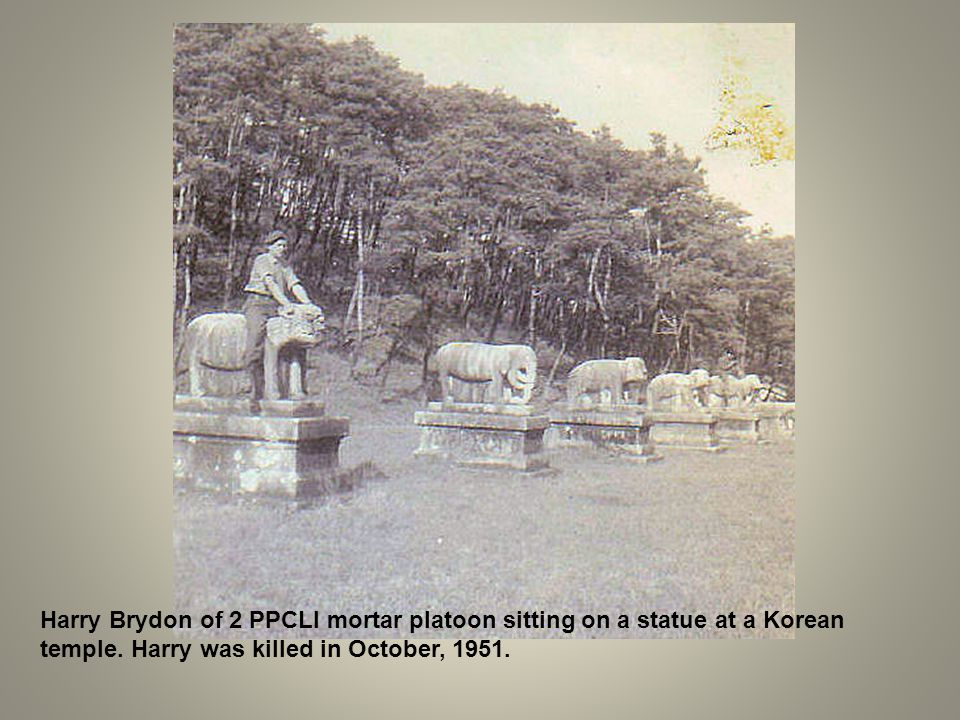 Harry Brydon of 2 PPCLI mortar platoon sitting on a statue at a Korean temple. Harry was killed in October, 1951.