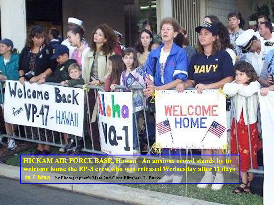 HICKAM AIR FORCE BASE, Hawaii –An anxious crowd stands by to