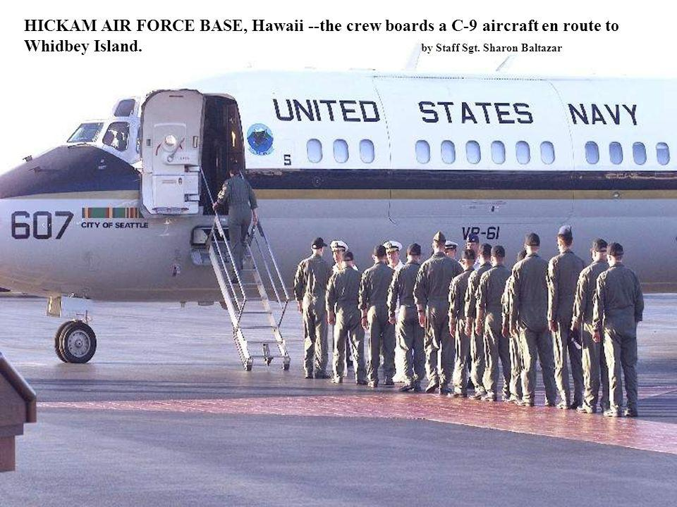 HICKAM AIR FORCE BASE, Hawaii --the crew boards a C-9 aircraft en route to