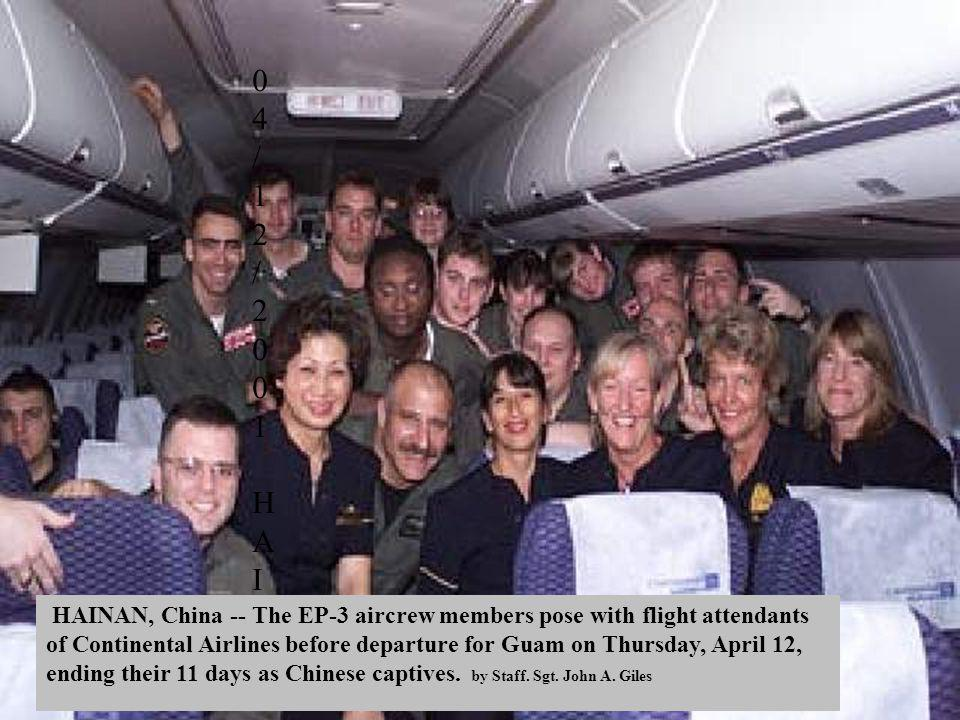 04/12/2001 HAINAN, China -- The EP-3 aircrew members pose with flight attendants of a commercially chartered airliner before departure for Guam on Thursday, April 12. (U.S. Pacific Command photo by Staff. Sgt. John A. Giles)