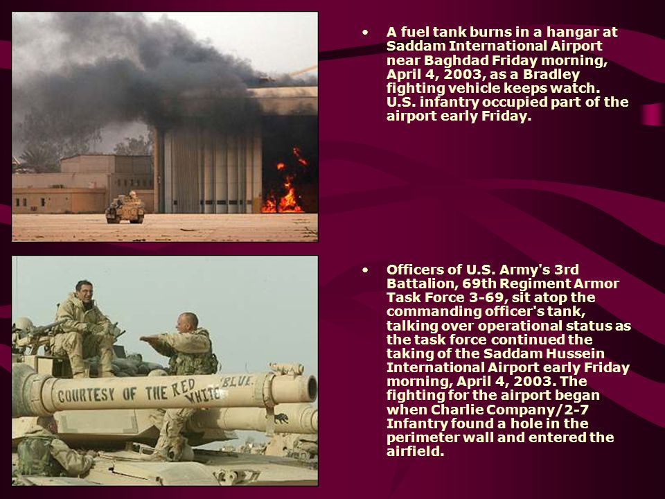 A fuel tank burns in a hangar at Saddam International Airport near Baghdad Friday morning, April 4, 2003, as a Bradley fighting vehicle keeps watch. U.S. infantry occupied part of the airport early Friday.