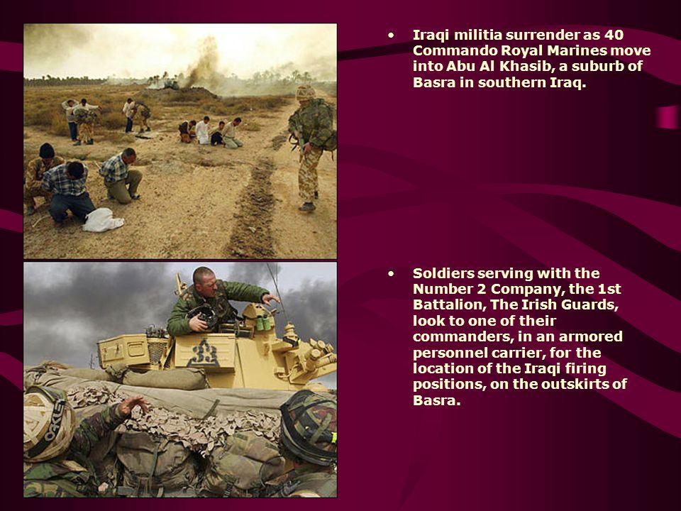 Iraqi militia surrender as 40 Commando Royal Marines move into Abu Al Khasib, a suburb of Basra in southern Iraq.