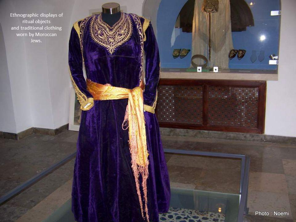 Ethnographic displays of ritual objects and traditional clothing worn by Moroccan Jews.