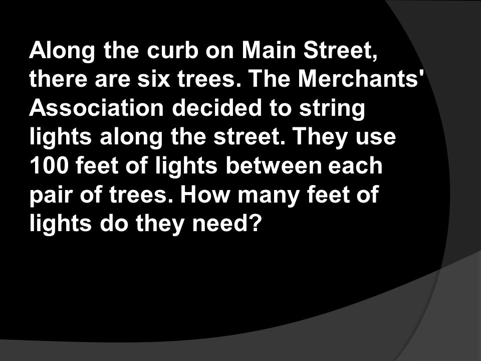 Along the curb on Main Street, there are six trees