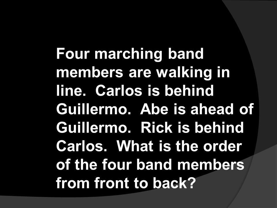 Four marching band members are walking in line