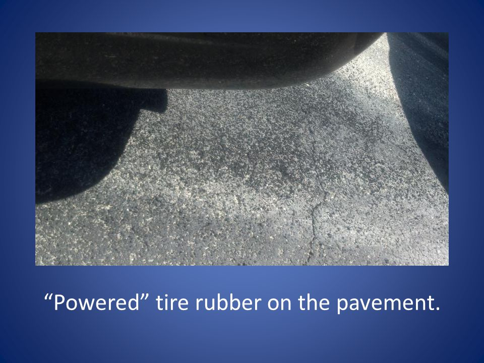 Powered tire rubber on the pavement.