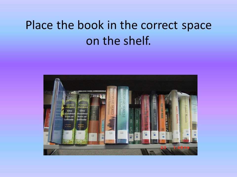 Place the book in the correct space on the shelf.