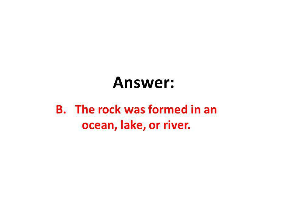B. The rock was formed in an ocean, lake, or river.
