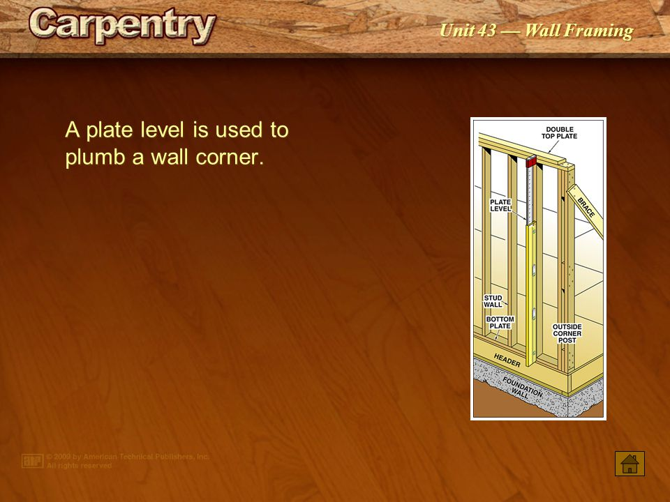 A plate level is used to plumb a wall corner.