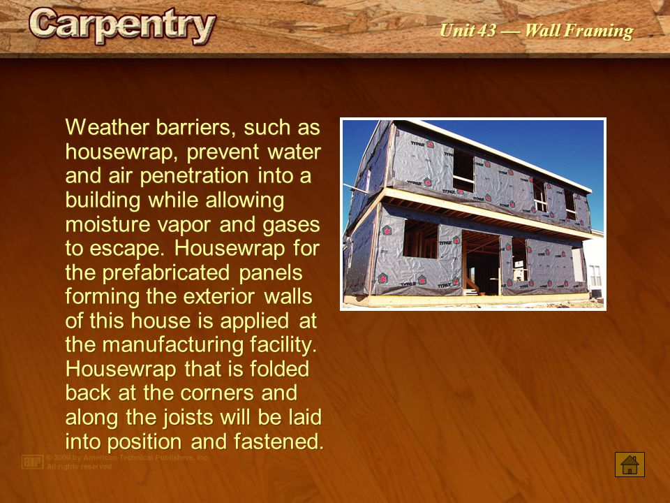 Weather barriers, such as housewrap, prevent water and air penetration into a building while allowing moisture vapor and gases to escape. Housewrap for the prefabricated panels forming the exterior walls of this house is applied at the manufacturing facility. Housewrap that is folded back at the corners and along the joists will be laid into position and fastened.