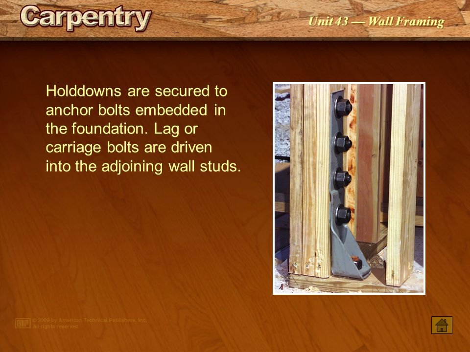 Holddowns are secured to anchor bolts embedded in the foundation
