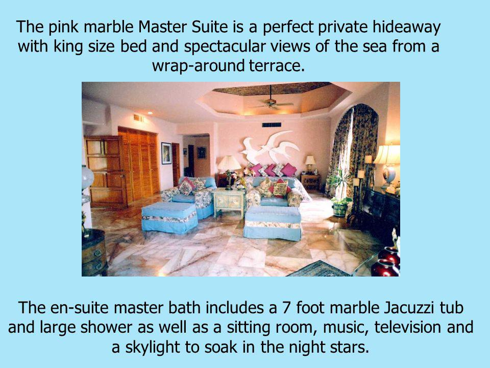 The pink marble Master Suite is a perfect private hideaway with king size bed and spectacular views of the sea from a wrap-around terrace.