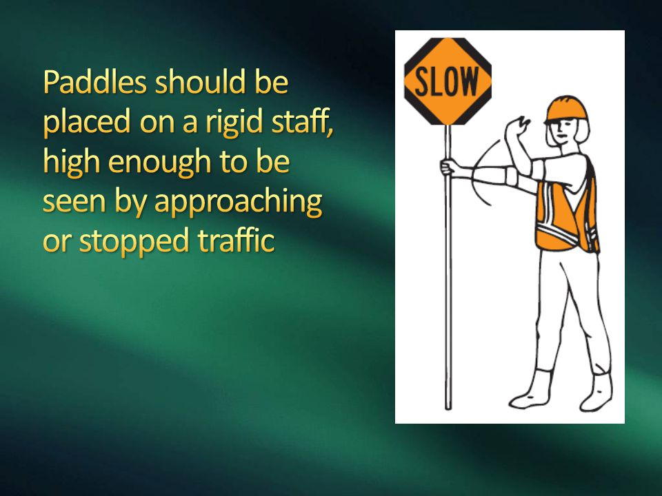 Paddles should be placed on a rigid staff, high enough to be seen by approaching or stopped traffic