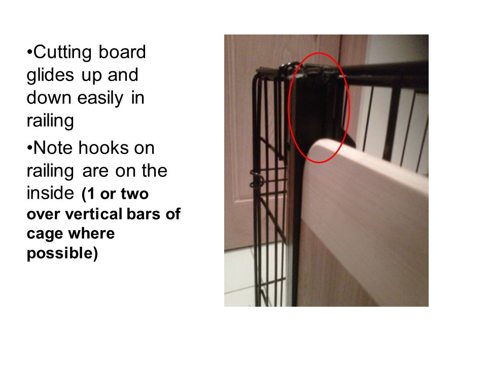 Cutting board glides up and down easily in railing