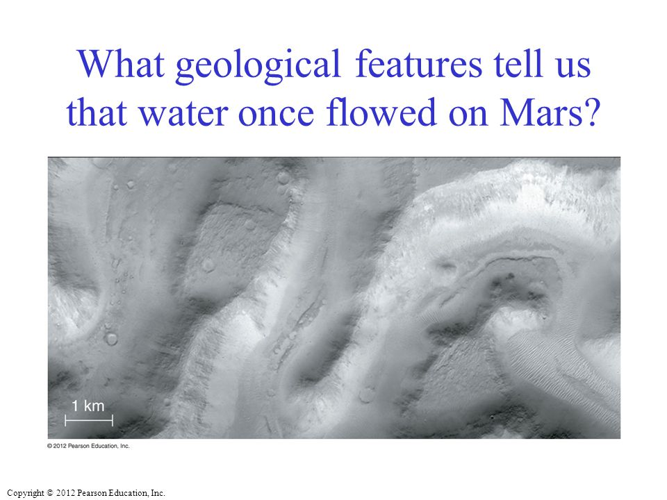 What geological features tell us that water once flowed on Mars