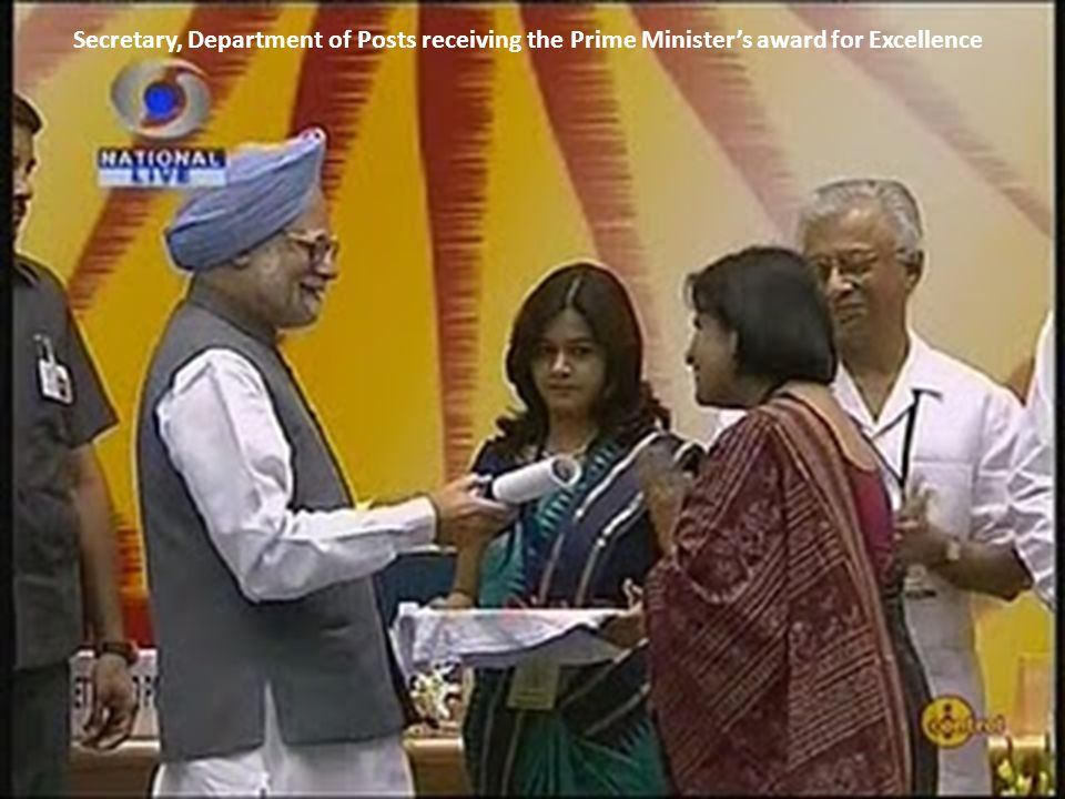 Secretary, Department of Posts receiving the Prime Minister's award for Excellence