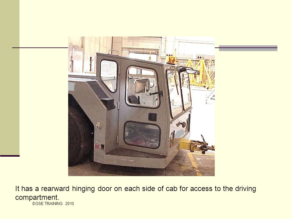 It has a rearward hinging door on each side of cab for access to the driving compartment.