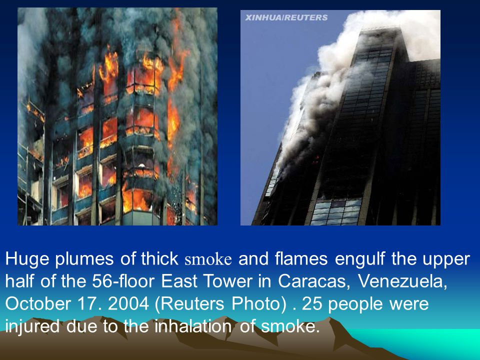 Huge plumes of thick smoke and flames engulf the upper half of the 56-floor East Tower in Caracas, Venezuela, October 17.