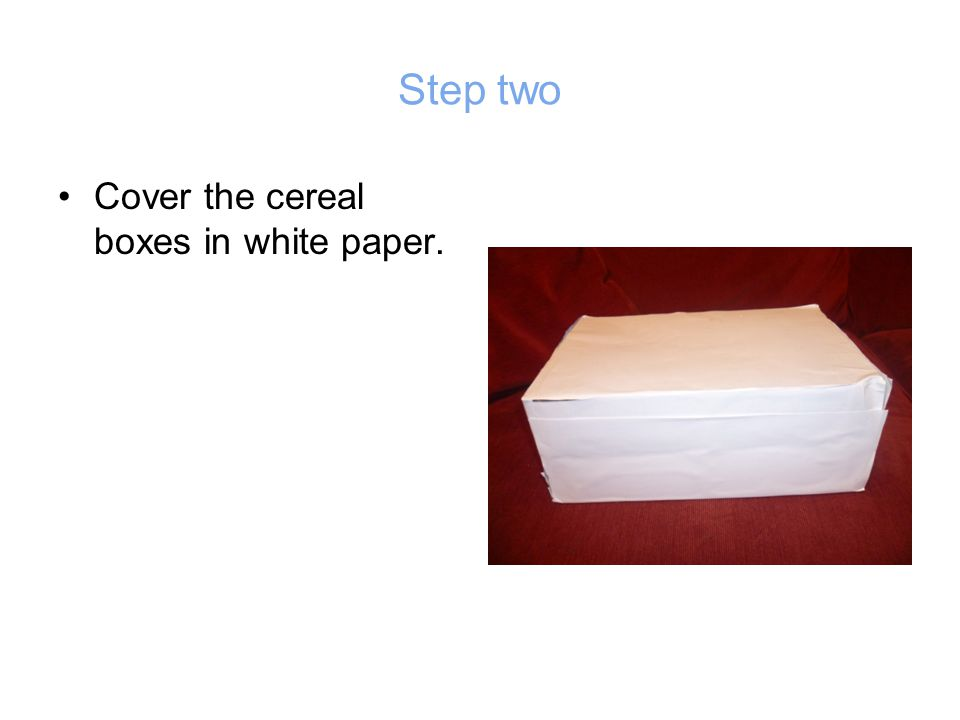 Step two Cover the cereal boxes in white paper.