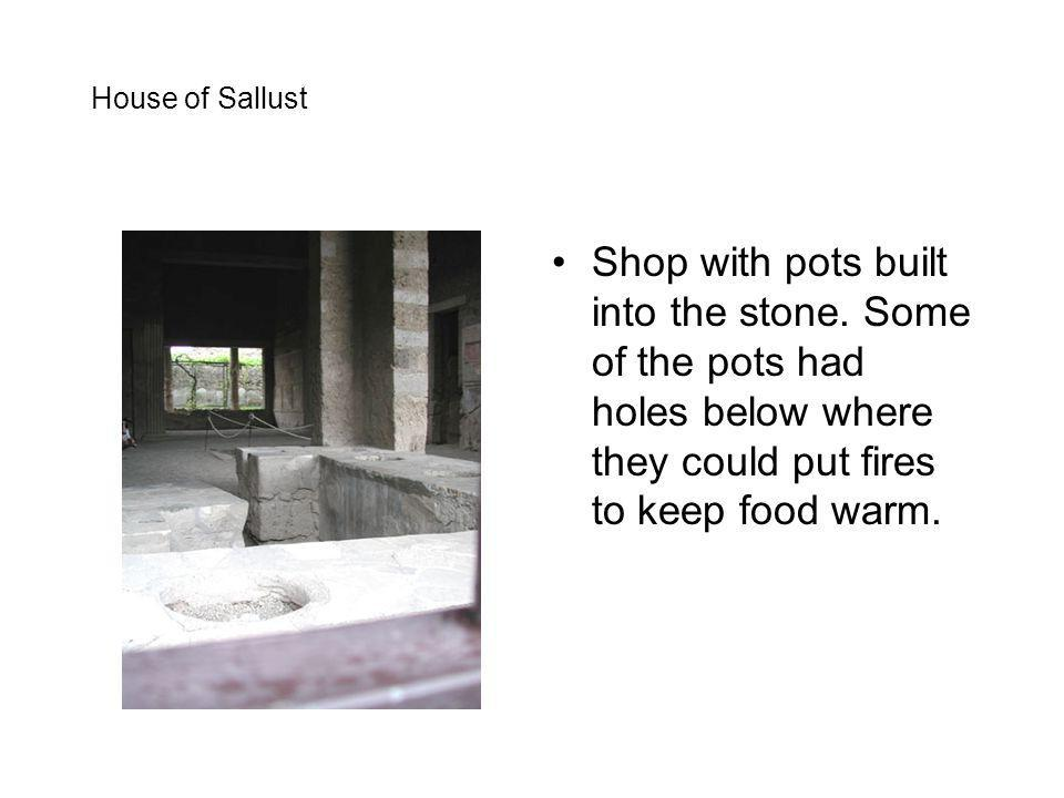 House of Sallust Shop with pots built into the stone.
