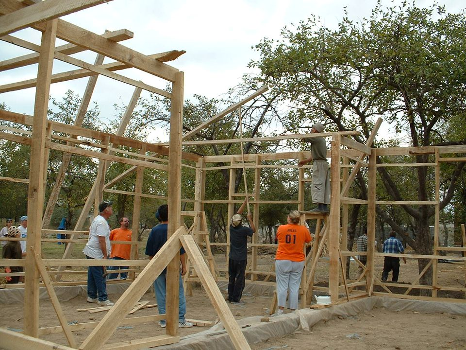 Global Village volunteers helped to constructed the main frame of the house.