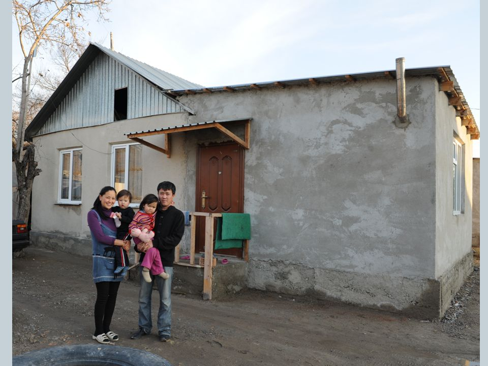 This is Imanaliev Niyazbek (30), his wife Edisa (26) and their children Edinay (4) Kanyshay (3) infront of their newly constructed Cane Reed home.