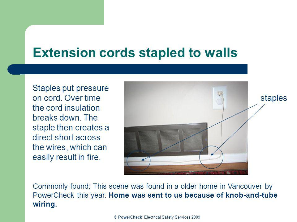 Extension cords stapled to walls